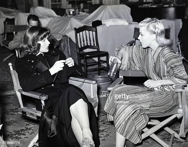 Katharine Hepburn and Ginger Rogers speak together on July 31 on the set of Stage Door