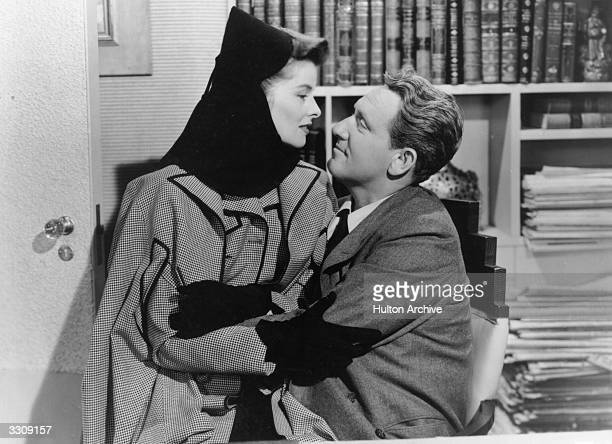 Katharine Hepburn and Spencer Tracy embrace in a scene from the film 'Woman Of The Year', directed by George Stevens for MGM. The film describes the...