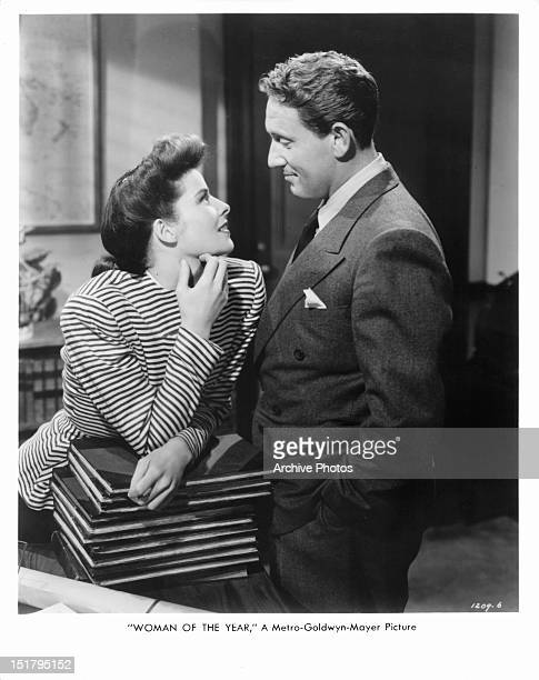 Katharine Hepburn and Spencer Tracy looking into each other eyes in a scene from the film 'Woman Of The Year', 1942.