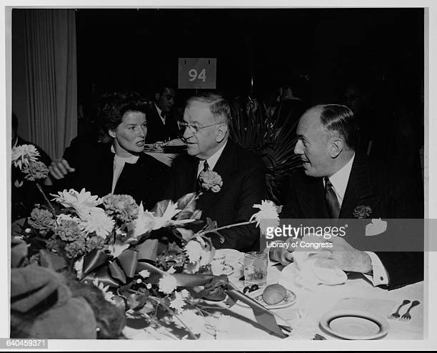 Katharine Hepburn dines with attorney Harold Ickes, middle, and Warner Brothers Studios vice president Jack L. Warner during a banquet in Washington,...