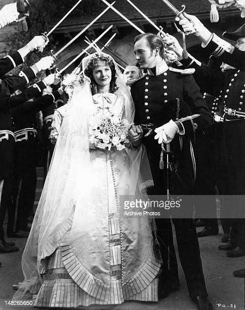 Katharine Hepburn Elizabeth Allan Donald Crisp and David Manners at wedding ceremony in a scene from the film 'A Woman Rebels' 1936