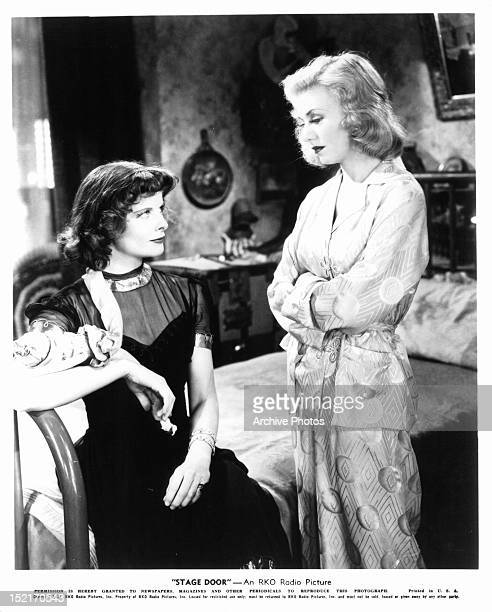 Katharine Hepburn looking up at Ginger Rogers in a scene from the film 'Stage Door' 1937