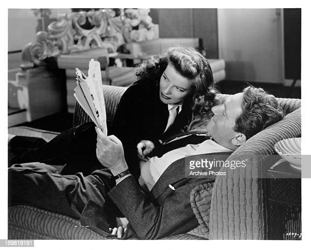 Katharine Hepburn on the couch with Spencer Tracy in a scene from the film 'Woman Of The Year', 1942.