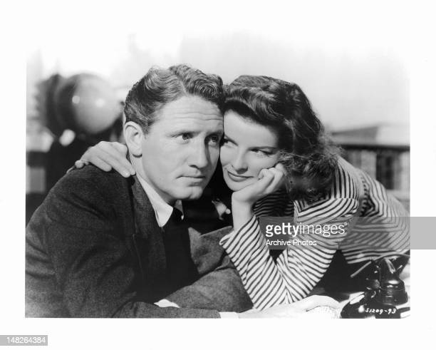 Katharine Hepburn putting her arm around Spencer Tracy in a scene from the film 'Woman Of The Year', 1942.