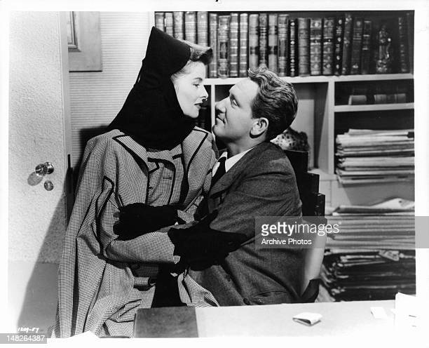Katharine Hepburn sitting on Spencer Tracy's lap in a scene from the film 'Woman Of The Year', 1942.