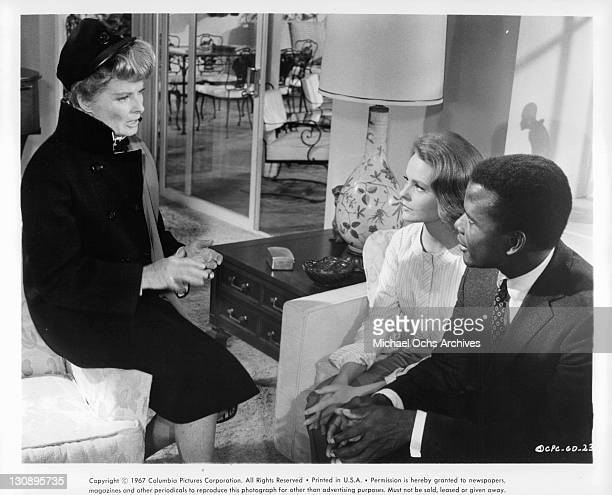 Katharine Hepburn speaks to Katharine Houghton and Sidney Poitier in a scene from the film 'Guess Who's Coming To Dinner' 1967