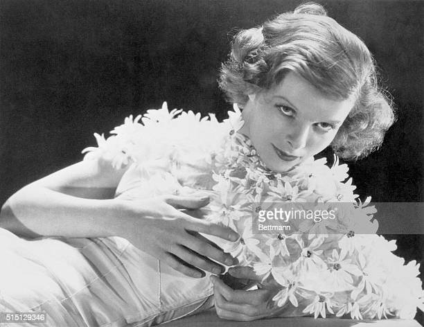 Katharine Hepburn, the Hartford, Connecticut girl who made good in the films is reported engaged to Howard Hughes, millionaire sportsman pilot who...