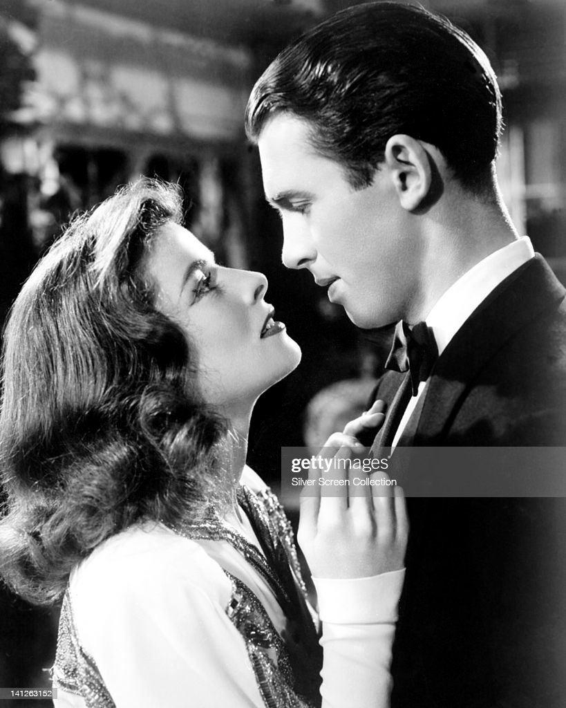 Katharine Hepburn (1907-2003), US actress, and James Stewart (1908-1997), US actor, in a passionate embrace in a publicity still issued for the film, 'The Philadelphia Story', USA, 1940. The romantic comedy, directed by George Cukor (1899-1983), starred Hepburn as 'Tracy Lord', and Stewart as 'Macaulay Connor'.