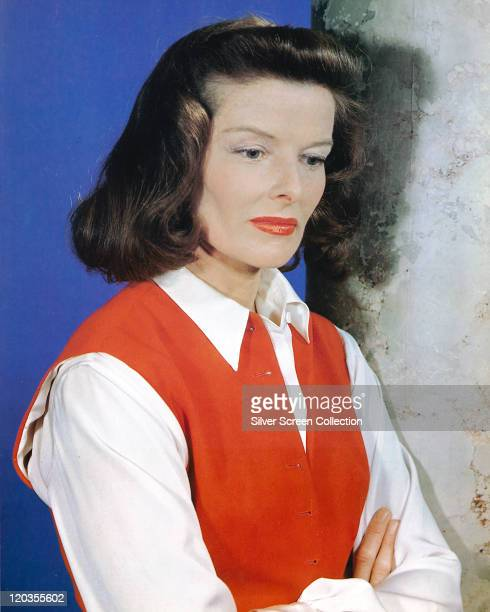 Katharine Hepburn US actress wearing a red waistcoat over a white blouse in a studio portrait circa 1950