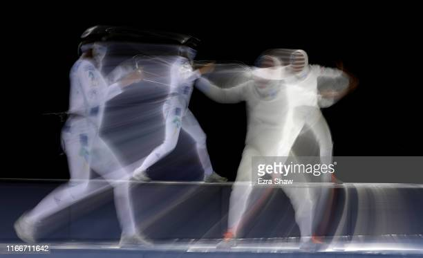 Katharine Holmes of the United States competes against Nathalie Marie Moellhausen of Brazil in the semifinals of the women's epee individual event on...