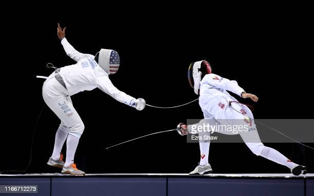 Katharine Holmes of the United States competes against Patrizia Silva Priovesan of Venezuela in the finals of the women's epee individual event on...