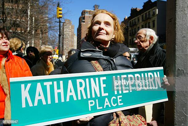 Katharine Houghton holds a replica of a street sign at the corner of 49th St and Second Ave as the Turtle Bay Association holds a ceremony to rename...