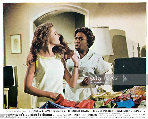 Katharine Houghton talking with the maid in a scene from the film 'Guess Who's Coming to Dinner' 1967