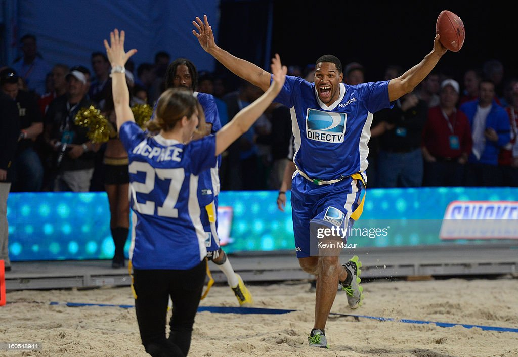Katharine McPhee and Michael Strahan attend DIRECTV'S 7th annual celebrity Beach Bowl at DTV SuperFan Stadium at Mardi Gras World on February 2, 2013 in New Orleans, Louisiana.