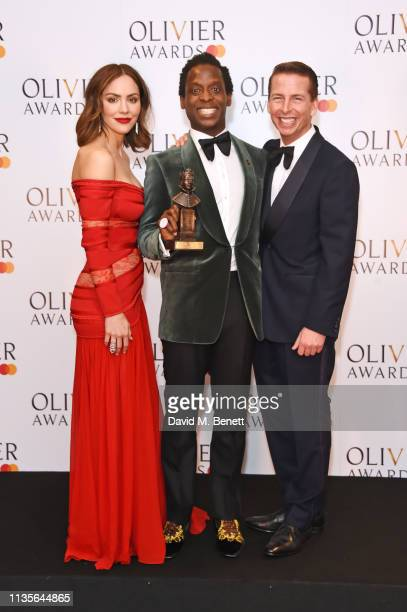 Katharine McPhee Kobna HoldbrookSmith winner of the Best Actor in a Musical award for Tina The Tina Turner Musical and Jack McBrayer pose in the...