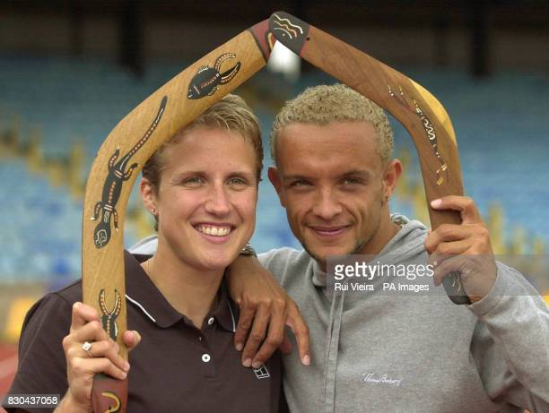 Katharine Merry from Scotland with fellow 400 metre runner Jamie Baulch from Wales holding boomerangs on the track at the Alexander Stadium in...