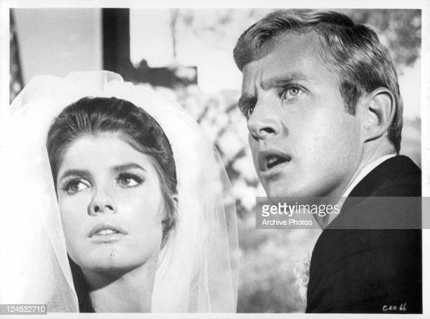 Katharine Ross and Brian Avery looking back during their wedding ceremony in a scene from the film 'The Graduate' 1967