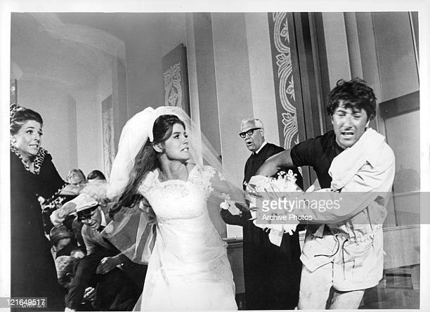Katharine Ross runs away with Dustin Hoffman at a wedding at the end from the film 'The Graduate' 1967