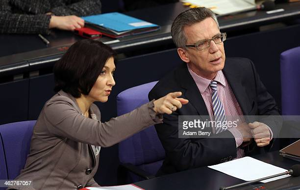 Katherina Reiche deputy chairman of the German CDU/CSU party's parliamentary group and Interior Minister Thomas de Maiziere attend a meeting of the...