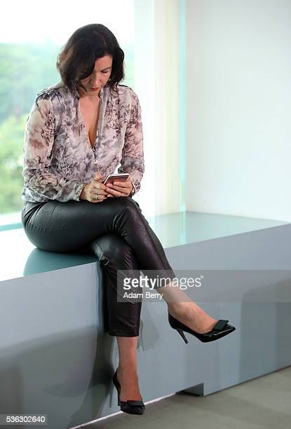 Katherina Reiche deputy chairman of the German CDU/CSU's parliamentary group uses her mobile phone as she arrives for the weekly German federal...
