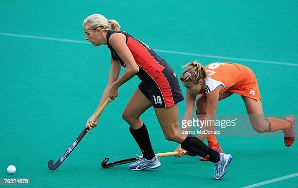Katherina Scholz of Germany battles with Wieke Dijkstra of Netherlands during the women's Final match between Netherlands and Germany on day eight of...