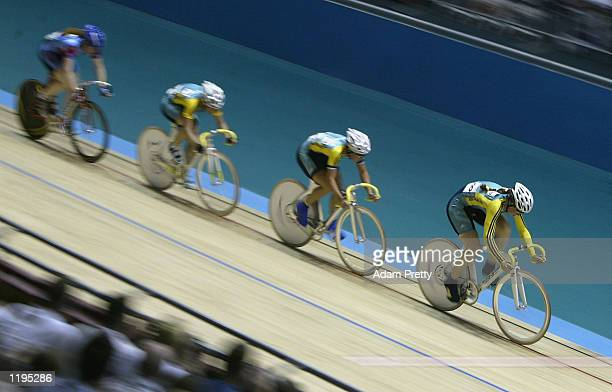 Katherine Bates leads Rochelle Gilmore and Alison Wright of Australia during the Women's 25 km Points Race Final at the National Cycling Centre...