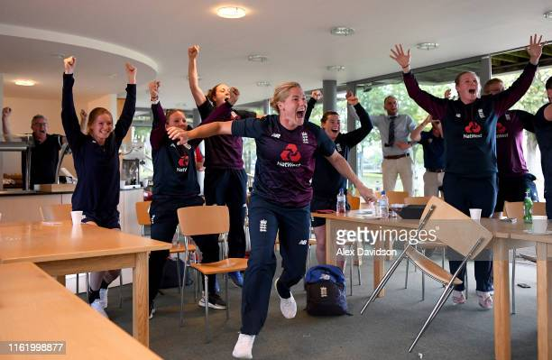 Katherine Brunt and Anya Shrubsole of England Women celebrate England men winning the Final of the ICC Cricket World Cup against New Zealand during...