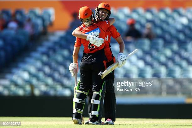 Katherine Brunt and Natalie Sciver of the Scorchers celebrate winning the Women's Big Bash League match between the Perth Scorchers and the Sydney...