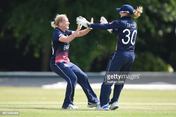 Katherine Brunt and Sarah Taylor of England Women's celebrate after they take a second wicket during the ICC women's world cup warm up match between...