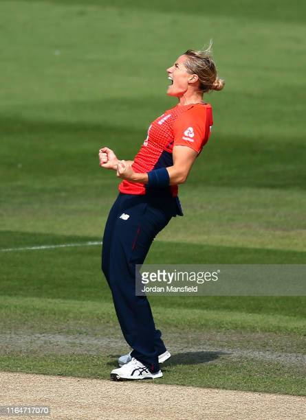 Katherine Brunt of England celebrates dismissing Alyssa Healy of Australia during the 2nd Vitality Women's IT20 at The 1st Central County Ground on...
