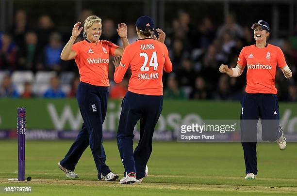Katherine Brunt of England celebrates running out Alyssa Healy of Australia during the first Natwest T20 match of the Women's Ashes Series between...