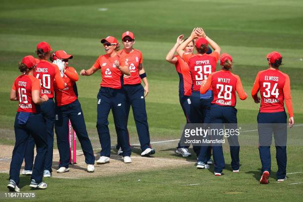 Katherine Brunt of England celebrates with her teammates after dismissing Alyssa Healy of Australia during the 2nd Vitality Women's IT20 at The 1st...