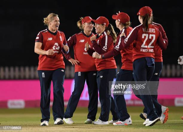 Katherine Brunt of England celebrates with teammates after dismissing Deandra Dottin of the West Indies during the 4th Vitality IT20 match between...