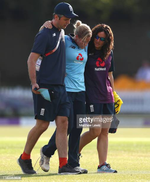 Katherine Brunt of England is helped off the field after an inury whilst celebrating bowling Meg Lanning of Australia during the 2nd Royal London...