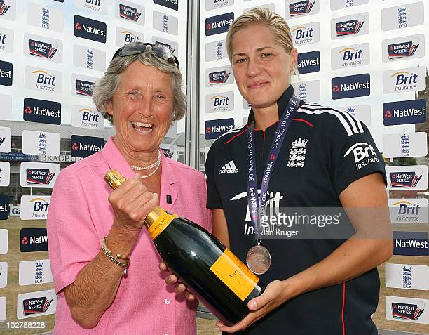 Katherine Brunt of England is presented with the Player of the Match medal and Champagne by Rachael HeyHoeFlint OBE and ECB Board member during the...
