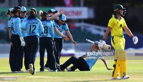 Katherine Brunt of England looks on after an injury during her celebrations after bowling Meg Lanning of Australia during the 2nd Royal London...