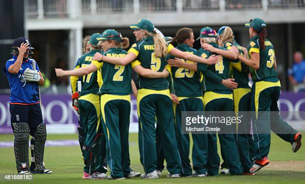 Katherine Brunt of England looks on as the Australia team celebrate their 63 run victory during the 2nd Royal London ODI of the Women's Ashes Series...