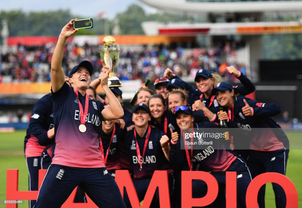 Katherine Brunt of England poses for a selfie with team-mates after winning the ICC Women's World Cup 2017 Final between England and India at Lord's Cricket Ground on July 23, 2017 in London, England.