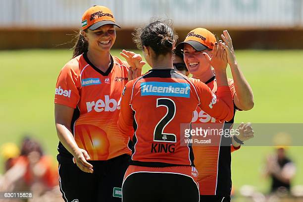 Katherine Brunt of the Scorchers celebrates after taking a catch to dismiss Deandra Dottin of the Heat during the WBBL match between the Brisbane...