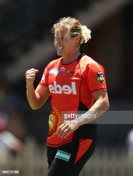 Katherine Brunt of the Scorchers celebrates taking the wicket of Beth Mooney of the Heat during the Women's Big Bash League WBBL match between the...