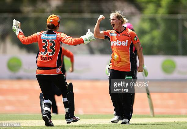 Katherine Brunt of the Scorchers celebrates taking the wicket of Ellyse Perry of the Sixers during the Women's Big Bash League match between the...