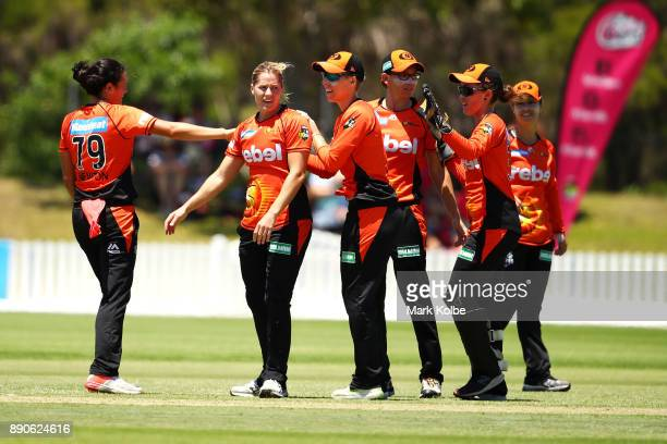 Katherine Brunt of the Scorchers celebrates with her team after taking the wicket of Sarah Aley of the Sixers during the Women's Big Bash League...
