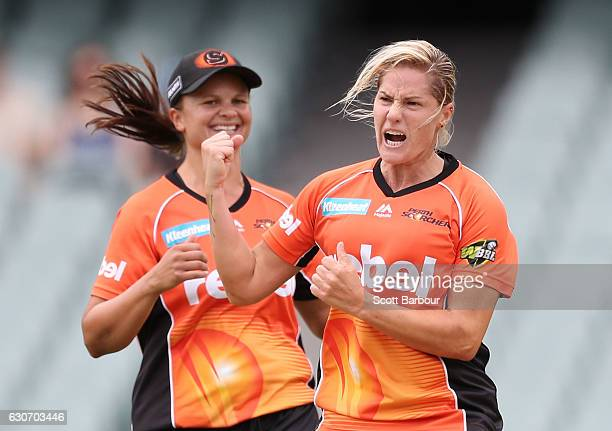 Katherine Brunt of the Scorchers celebrates with Suzie Bates captain of the Scorchers after dismissing Sophie Devine of the Strikers during the WBBL...