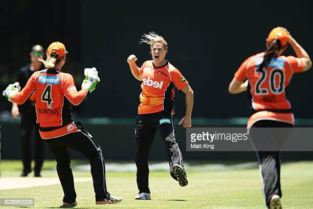 Katherine Brunt of the Scorchers celebrates with team mates after taking the wicket of Hayley Matthews of the Hurricanes during the Women's Big Bash...