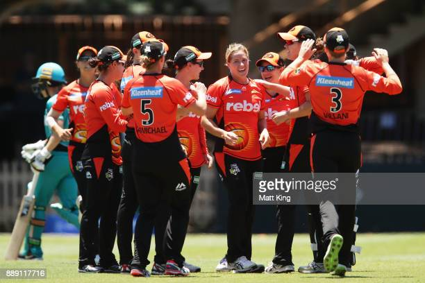 Katherine Brunt of the Scorchers celebrates with team mates after taking the wicket of Kirby Short of the Heat during the Women's Big Bash League...