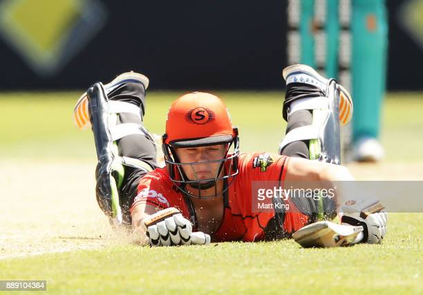 Katherine Brunt of the Scorchers slides in to avoid a runout during the Women's Big Bash League WBBL match between the Perth Scorchers and the...