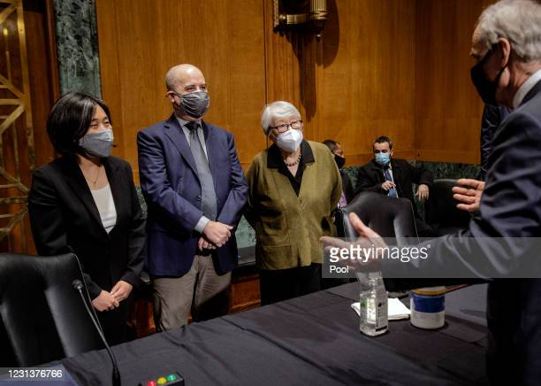 Katherine C. Tai, left, of the District of Columbia, greets Sen. Tom Carper before the Senate Finance Committee hearing at the US Capitol on February...