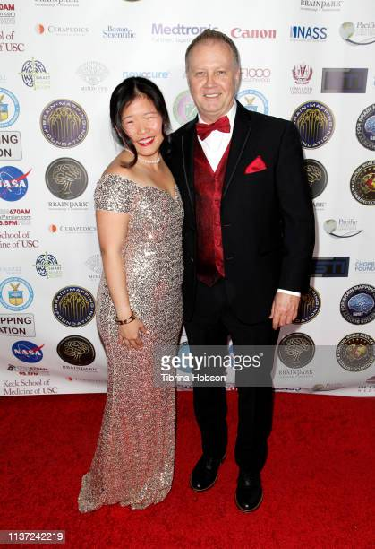 Katherine Chu and David Grimes attend the 16th annual 'Gathering for Cure' black tie awards gala of Brain Mapping Foundation on March 16 2019 in Los...