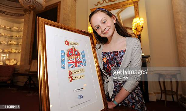 Katherine Dewar from Chester waits to show Queen Elizabeth II her winning design for an emblem for the Queen's Diamond Jubilee, in a competition run...