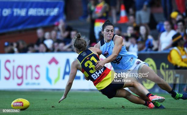 Katherine GillespieJones of Carlton tackles Dayna Cox of the Adelaide Crows during the round five AFLW match between the Adelaide Crows and the...
